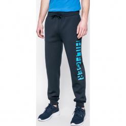 Tommy Hilfiger - Spodnie piżamowe. Szare piżamy męskie Tommy Hilfiger, z nadrukiem, z dzianiny. W wyprzedaży za 179.90 zł.