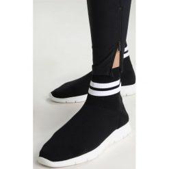 Peak Performance TRACK  Spodnie materiałowe black. Spodnie materiałowe męskie Peak Performance, z elastanu, sportowe. Za 799.00 zł.