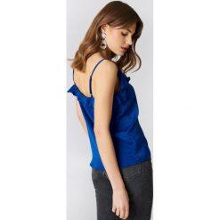 Rut&Circle Koszulka z falbanką Rosalie - Blue. Niebieskie t-shirty damskie Rut&Circle, z poliesteru, z falbankami. Za 100.95 zł.