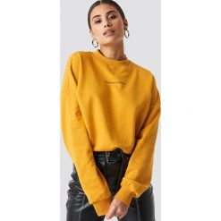 NA-KD Trend Bluza Passionate - Orange,Yellow. Pomarańczowe bluzy damskie NA-KD Trend, z nadrukiem, z dzianiny. Za 161.95 zł.