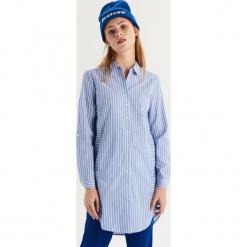 Długa koszula w paski - Niebieski. Niebieskie koszule damskie Sinsay, w paski, z długim rękawem. Za 79.99 zł.