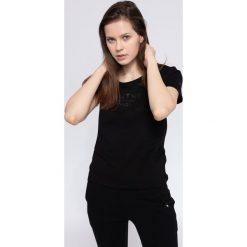 T-shirt damski TSD236 - czarny. T-shirty damskie marki DOMYOS. Za 39.99 zł.