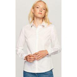Koszula z ozdobnym kołnierzem - Biały. Koszule damskie marki SOLOGNAC. Za 99.99 zł.