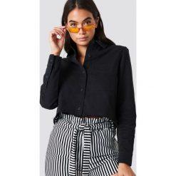 NA-KD Trend Koszula jeansowa z surowym brzegiem - Black. Czarne koszule damskie NA-KD Trend, z jeansu. Za 161.95 zł.