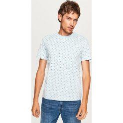 T-shirt z mikroprintem - Niebieski. Niebieskie t-shirty męskie Reserved. Za 49.99 zł.