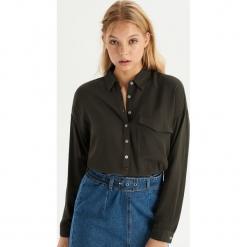 Koszula z kieszenią - Khaki. Koszule damskie marki SOLOGNAC. W wyprzedaży za 29.99 zł.