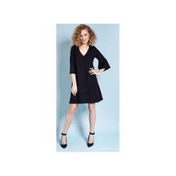 Eteryczna Lisa - sukienka - czarna. Czarne sukienki damskie Madnezz, eleganckie, dekolt w kształcie v. Za 229.00 zł.