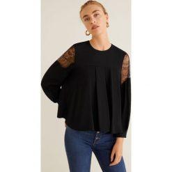Mango - Bluzka Xoco. Czarne bluzki damskie Mango, z dzianiny, eleganckie, z okrągłym kołnierzem. Za 139.90 zł.