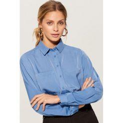 Klasyczna koszula - Niebieski. Koszule damskie marki SOLOGNAC. Za 99.99 zł.