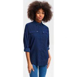 Koszula z podwijanymi rękawami - Granatowy. Koszule damskie marki SOLOGNAC. Za 99.99 zł.