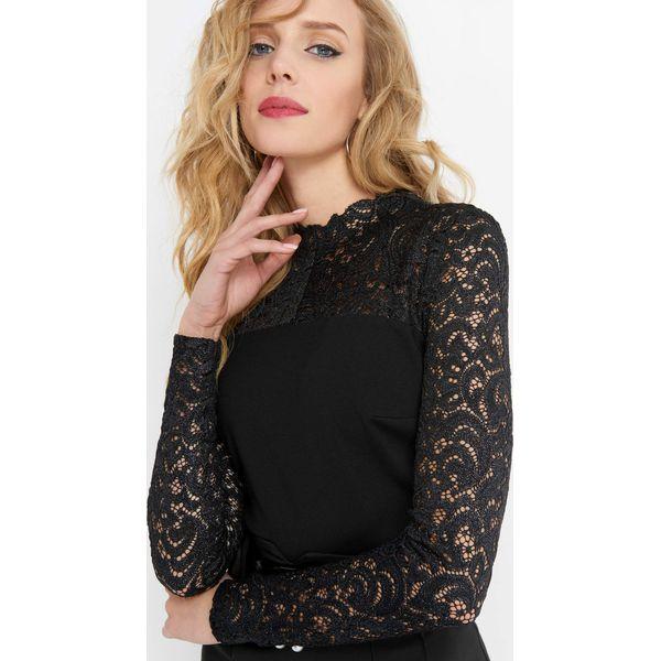 18ea72f4853ea9 Koronkowa bluzka ze stójką - Bluzki damskie Orsay. Za 79.99 zł ...