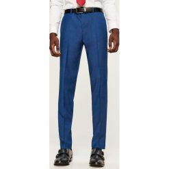 Spodnie garniturowe slim fit - Niebieski. Eleganckie spodnie męskie marki Giacomo Conti. W wyprzedaży za 89.99 zł.