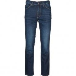 """Dżinsy """"Tramper"""" - Regular fit - w kolorze niebieskim. Niebieskie jeansy męskie Mustang. W wyprzedaży za 152.95 zł."""