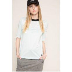 Nike Sportswear - Top. Szare topy damskie Nike Sportswear, z bawełny, z okrągłym kołnierzem, z krótkim rękawem. W wyprzedaży za 119.90 zł.