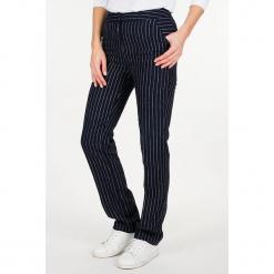 """Lniane spodnie """"Linray"""" w kolorze granatowo-białym. Niebieskie spodnie materiałowe damskie Scottage, w paski, ze lnu. W wyprzedaży za 86.95 zł."""