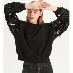 Bluza z błyszczącymi cekinami - Czarny. Czarne bluzy damskie Sinsay. Za 79.99 zł.