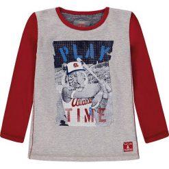 Koszulka w kolorze szaro-czerwonym. T-shirty dla chłopców marki Reserved. W wyprzedaży za 32.95 zł.