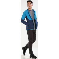 Dynafit Spodnie materiałowe asphalt. Spodnie materiałowe męskie Dynafit, z bawełny, sportowe. W wyprzedaży za 494.10 zł.