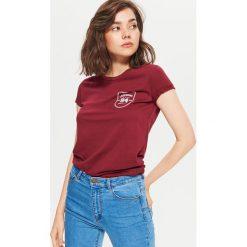 Koszulka z nadrukiem - Bordowy. T-shirty damskie marki DOMYOS. W wyprzedaży za 14.99 zł.