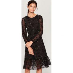 Sukienka w kwiaty - Czarny. Czarne sukienki damskie Mohito, w kwiaty. Za 149.99 zł.