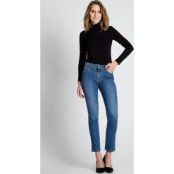 Niebieskie jeansowe spodnie  BIALCON. Niebieskie spodnie sportowe damskie BIALCON, w paski, z jeansu. Za 229.00 zł.