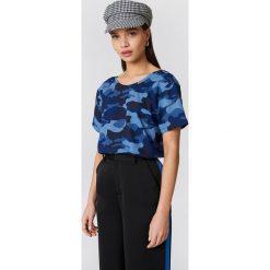 NA-KD T-shirt moro z dekoltem na plecach - Blue. Niebieskie t-shirty damskie NA-KD, moro, z bawełny, z dekoltem na plecach. W wyprzedaży za 40.48 zł.