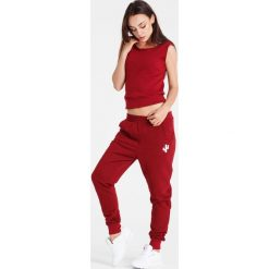 Naoko - Spodnie The Best Things Rouge. Spodnie sportowe damskie marki WED'ZE. W wyprzedaży za 129.90 zł.