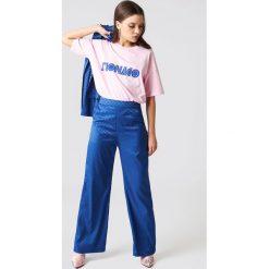 NA-KD Spodnie dzwony z wysokim stanem - Blue. Niebieskie spodnie materiałowe damskie NA-KD, z materiału. W wyprzedaży za 97.17 zł.