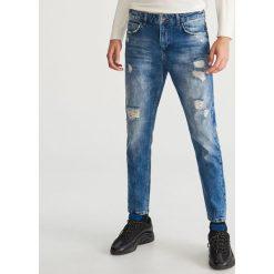 Przecierane jeansy - Niebieski. Niebieskie jeansy męskie Reserved. Za 149.99 zł.