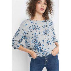 Bluzka w kwiaty. Niebieskie bluzki damskie Orsay, w kwiaty, z materiału. Za 89.99 zł.