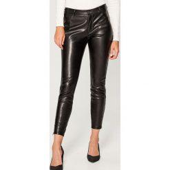Spodnie skinny - Czarny. Spodnie materiałowe damskie marki DOMYOS. W wyprzedaży za 99.99 zł.