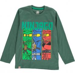 Koszulka w kolorze ciemnozielonym. Zielone t-shirty dla chłopców marki Lego Wear Fashion, z bawełny, z długim rękawem. W wyprzedaży za 35.95 zł.