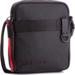 Saszetka CALVIN KLEIN - City Active Mini Reporter K50K503920  910. Czarne saszetki męskie Calvin Klein, z materiału, młodzieżowe. Za 349.00 zł.