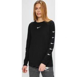 Nike Sportswear - Bluzka. Czarne bluzki damskie Nike Sportswear, z nadrukiem, z bawełny, casualowe, z okrągłym kołnierzem. Za 159.90 zł.