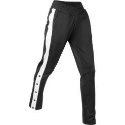 Spodnie sportowe, z rozpinanymi nogawkami, długie bonprix czarny. Spodnie dresowe damskie marki bonprix. Za 89.99 zł.