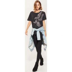 Koszulka oversize z nadrukiem - Szary. T-shirty damskie marki DOMYOS. W wyprzedaży za 19.99 zł.