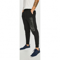Calvin Klein Performance - Spodnie. Szare spodnie sportowe męskie Calvin Klein Performance, z nadrukiem, z bawełny. Za 299.90 zł.