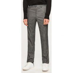 Spodnie na kant slim fit - Szary. Eleganckie spodnie męskie marki Giacomo Conti. W wyprzedaży za 119.99 zł.