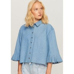 Jeansowa koszula z szerokimi rękawami - Niebieski. Koszule damskie marki SOLOGNAC. W wyprzedaży za 59.99 zł.