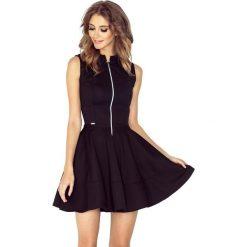 123-12 sukienka z ekspresem z przodu i kieszonkami - drobna lacosta cz. Czarne sukienki damskie NUMOCO, z materiału, z długim rękawem. Za 131.00 zł.