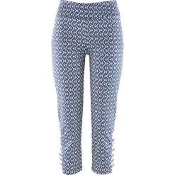 Spodnie ze stretchem Premium 3/4 bonprix indygo-biel wełny z nadrukiem. Spodnie materiałowe damskie marki DOMYOS. Za 129.99 zł.