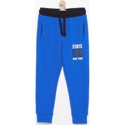 Spodnie dresowe - Niebieski. Spodnie sportowe dla chłopców marki 4f. Za 39.99 zł.