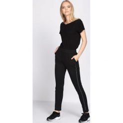 Czarne Spodnie Dresowe Extradition. Czarne spodnie dresowe damskie Born2be, z dresówki. Za 59.99 zł.