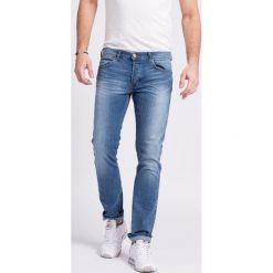 Wrangler - Jeansy Spencer Fired Up. Niebieskie jeansy męskie Wrangler. W wyprzedaży za 249.90 zł.