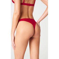 Andrea Hedenstedt x NA-KD Dół bikini - Red. Czerwone bikini damskie Andrea Hedenstedt x NA-KD. W wyprzedaży za 36.57 zł.