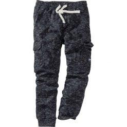 Spodnie sportowe z kieszeniami z boku nogawki bonprix czarny melanż. Spodnie sportowe męskie marki bonprix. Za 109.99 zł.