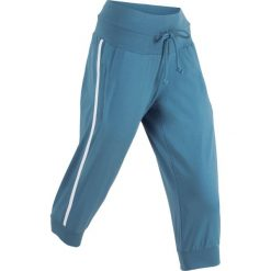 Spodnie sportowe 3/4 bonprix niebieski dżins. Niebieskie spodnie dresowe damskie bonprix. Za 59.99 zł.