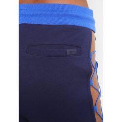 Fenty PUMA by Rihanna LACED  Spodnie treningowe evening blue. Spodnie dresowe damskie Fenty PUMA by Rihanna, z bawełny. Za 759.00 zł.