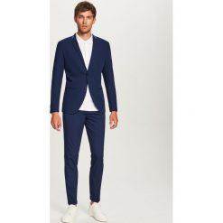 Spodnie garniturowe slim fit - Granatowy. Eleganckie spodnie męskie marki Giacomo Conti. W wyprzedaży za 89.99 zł.