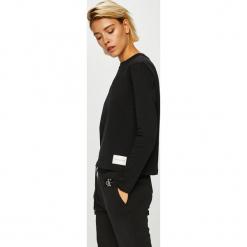 Calvin Klein Jeans - Bluzka. Czarne bluzki damskie Calvin Klein Jeans, z bawełny, casualowe, z okrągłym kołnierzem. Za 229.90 zł.